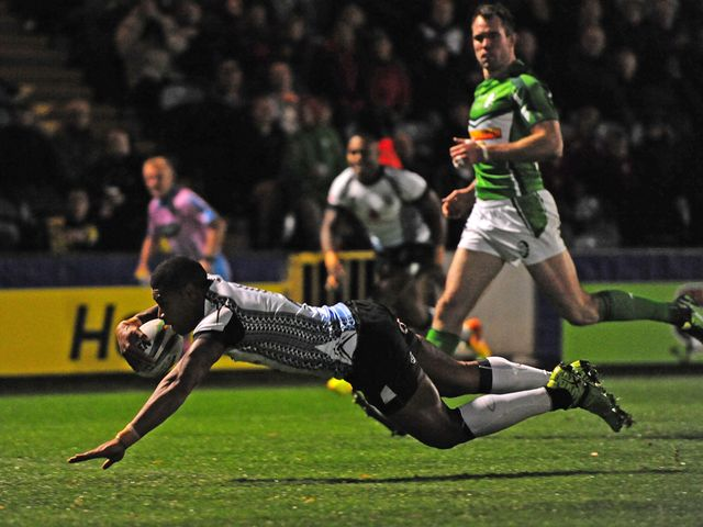 Kevin Naiqama dives over to score against Ireland