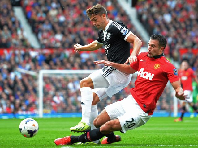 Robin Van Persie slides in on Jay Rodriguez