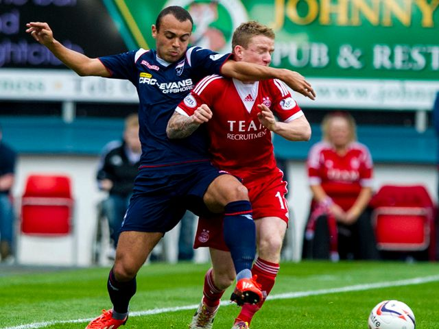 Ben Gordon tussles for the ball with Aberdeen's Jonny Hayes