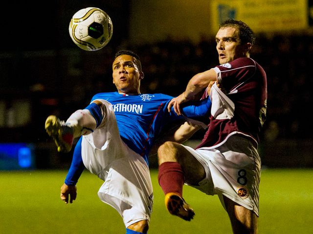 Arnold Peralta tussles with David Rowson