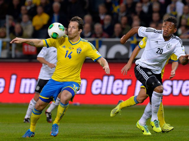 Tobias Hysen shields the ball from Jerome Boateng