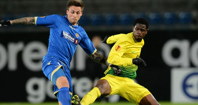 Steffen Nystrom: Vies with Ayodele Adeleye for possession