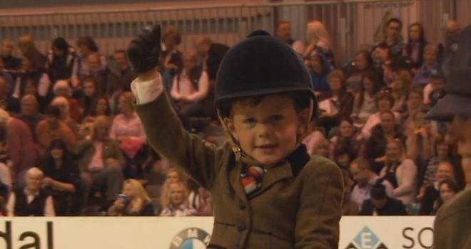 Three-year-old Harry Edwards-Brady becomes the youngest Horse of the Year Show rider in history.
