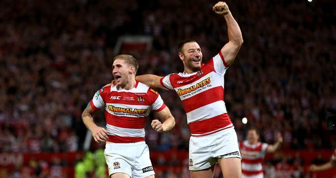 Sam Tomkins (left) and Blake Green celebrate Wigan's victory