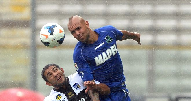 Parma's Walter Gargano and Sassuolo's Simone Zaza compete for a header