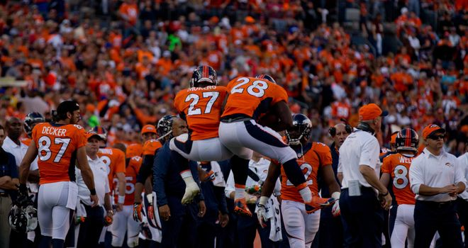 Montee Ball (28) celebrates his first career touchdown with Knowshon Moreno (27)