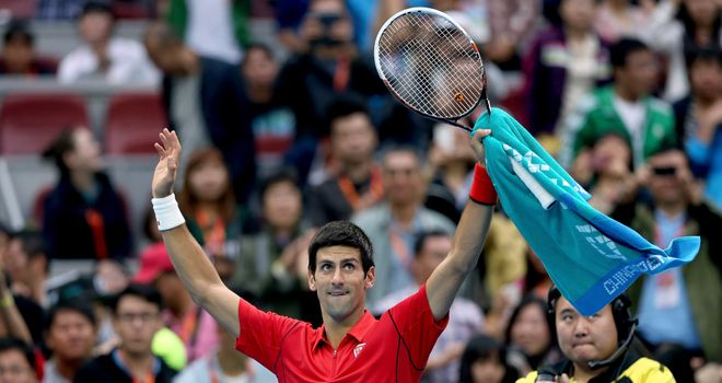 Novak Djokovic: Celebrates winning his match at the China Open