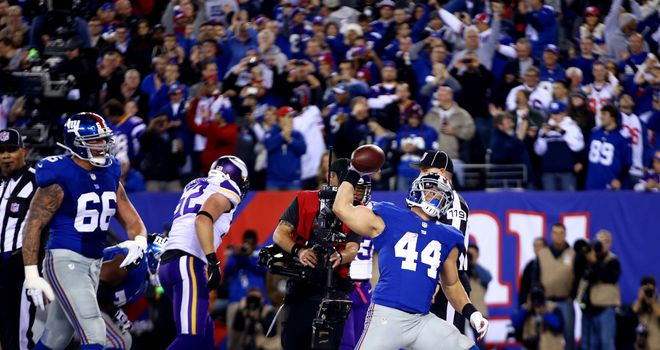 Peyton Hillis celebrates his debut touchdown for the Giants
