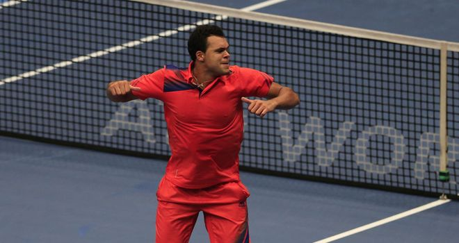 Jo-Wilfried Tsonga celebrates after overcoming Daniel Brands