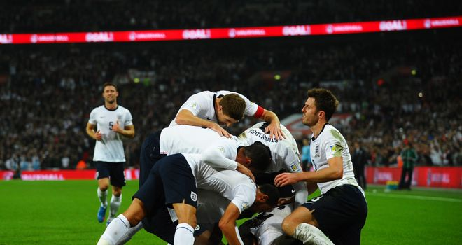 England celebrate Wayne Rooney's goal on the way to a 2-0 win over Poland