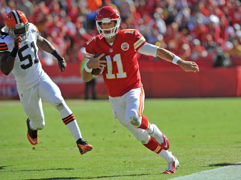 Alex Smith runs for a first down