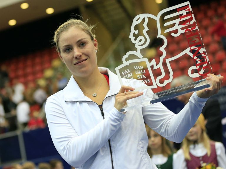 Angelique Kerber celebrates with her trophy.