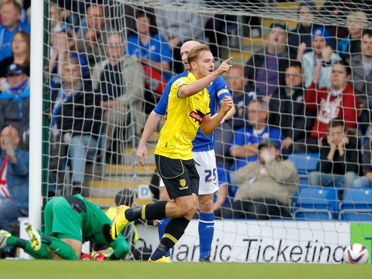 Adam McGurk celebrates his second goal for Burton at Chesterfield