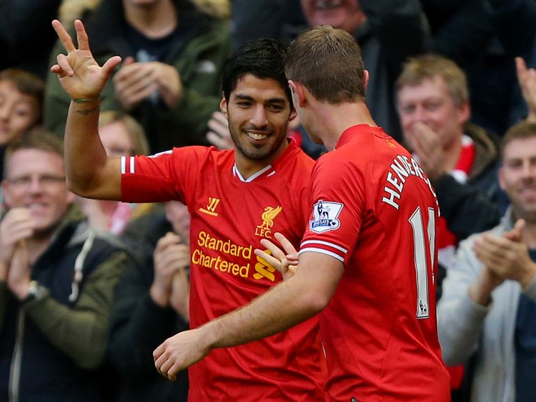 Luis Suarez enjoys his hat-trick on Saturday afternoon.