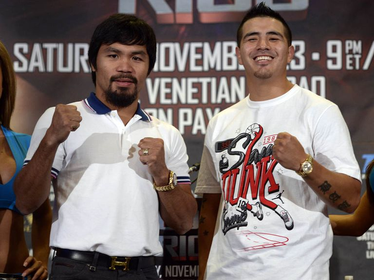 Pacquiao (l) and Rios clash in China on November 23