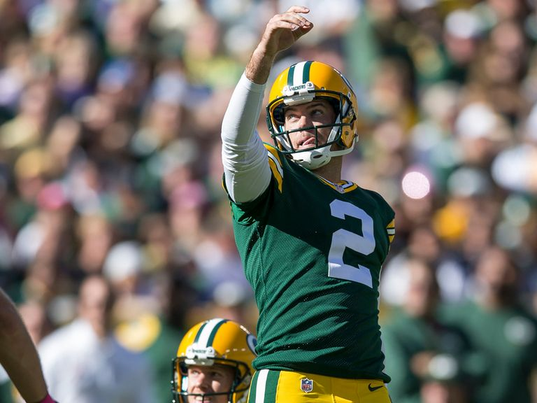 Mason Crosby celebrates one of his five field goals