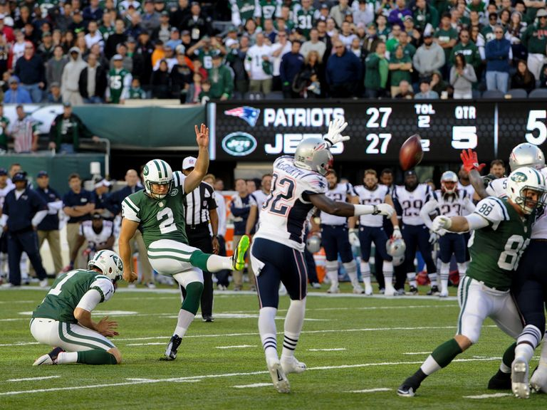 Nick Folk kicks the winning field goal for the Jets