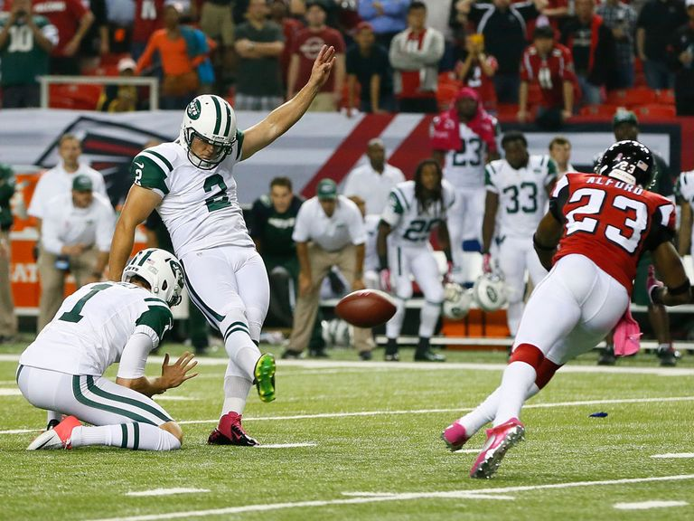 Nick Folk kicks the game-winning field goal for the New York Jets