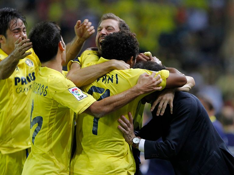Villarreal players celebrate victory over rivals Valencia
