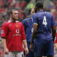 Wayne Rooney and Patrick Vieira exchange pleasantries during the 2004 clash