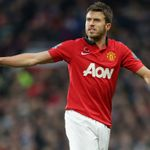 Michael Carrick: Capable of dropping into defence