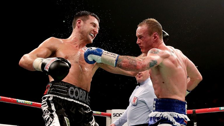 Carl Froch retained titles after a brutal battle with George Groves
