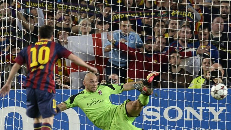Lionel Messi scores from the penalty spot against AC Milan