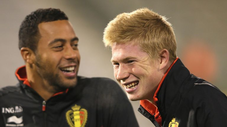 Kevin De Bruyne (right): Sharing a joke with Moussa Dembele