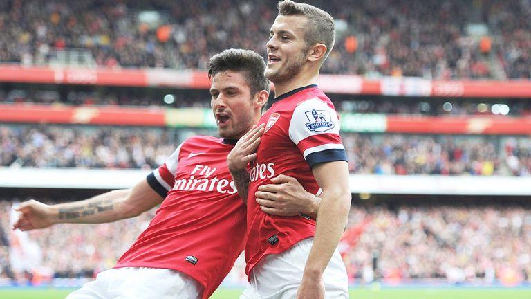 Jack Wilshere (r): Celebrates with Arsenal striker Olivier Giroud