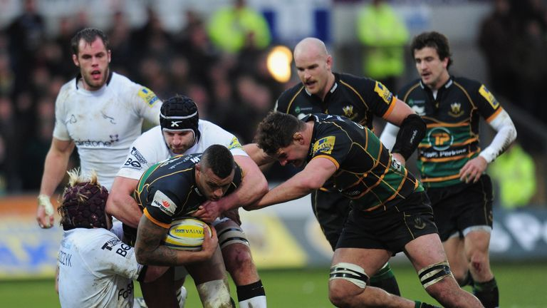 Courtney Lawes is tackled by Oliver Tomaszczyk and Fraser McKenzie