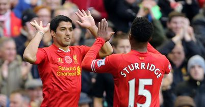 Luis Suarez: Celebrates one of his goals against Fulham with Daniel Sturridge