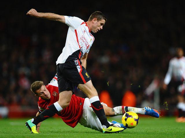 Ramsey tackles Henderson