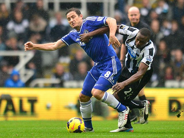 Frank Lampard and Shola Ameobi tangle.