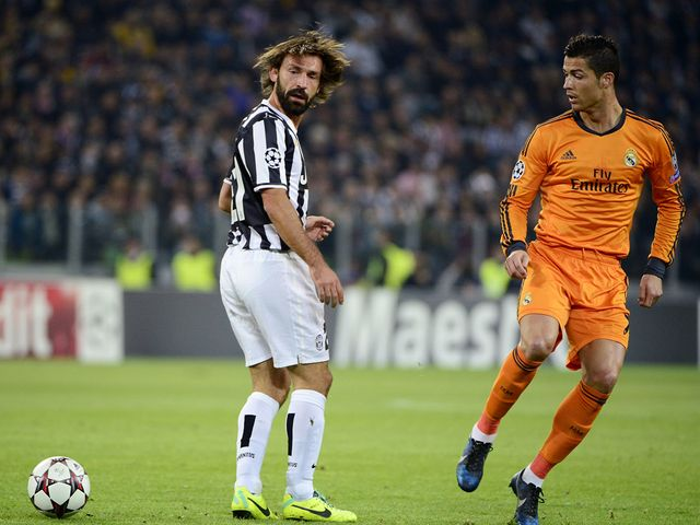 Andrea Pirlo and Cristiano Ronaldo in action in Turin