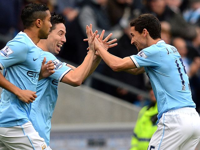 Samir Nasri celebrates with Jesus Navas