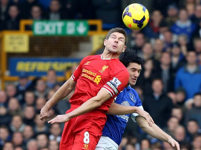 Steven Gerrard wins a header against Gareth Barry