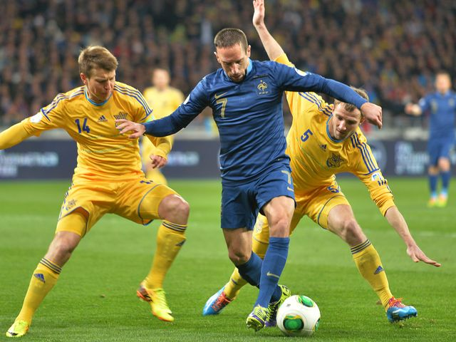 Franck Ribery battles for the ball against Ukraine