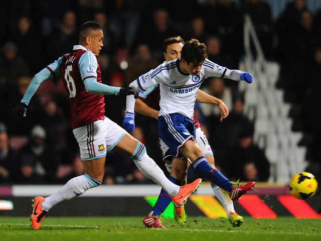 Oscar takes a shot under pressure from Ravel Morrison