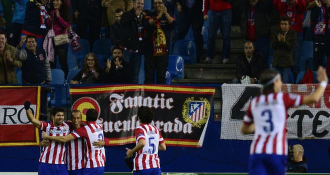 Joao Miranda: Celebrates his opener for Atletico