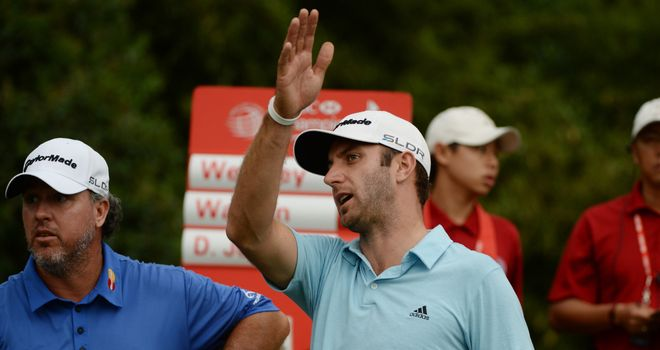 Dustin Johnson reacts to his tee-shot at 18 that found water