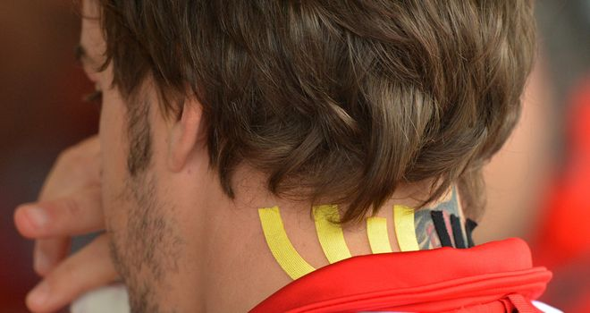 Fernando Alonso: Had his back taped in Austin
