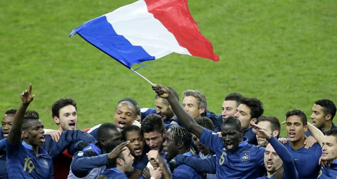 The France squad celebrate qualifying for the World Cup