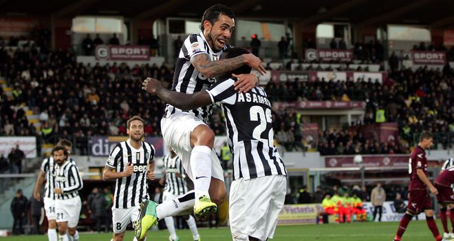 Carlos Tevez celebrates after finding the net for Juventus