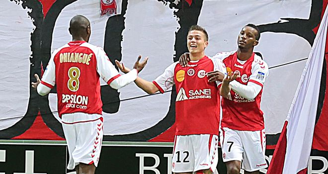 Nicolas De Preville and Reims celebrate.