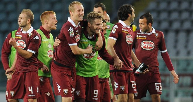 Torino players celebrate their victory