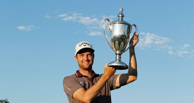 Chris Kirk poses with the trophy after winning The McGladrey Classic at Sea Island's Seaside Course