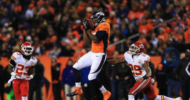 Julius Thomas  of the Denver Broncos completes a reception against the Kansas City Chiefs