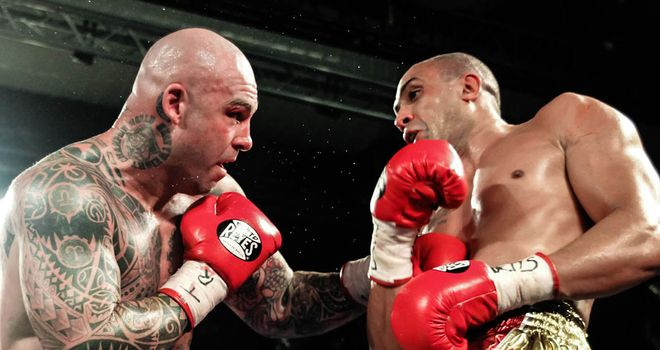Lucas Browne puts the pressure on Richard Towers prior to the stoppage