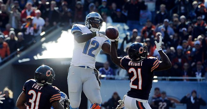 Major Wright of the Chicago Bears and Jeremy Ross of the Detroit Lions go up for the ball at Soldier Field