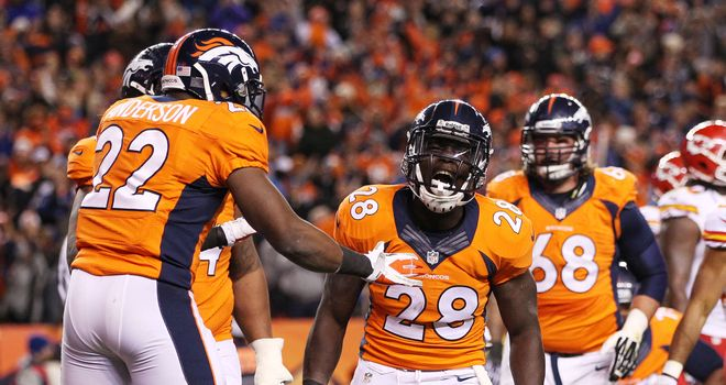Montee Ball (28) celebrates scoring a second-quarter touchdown